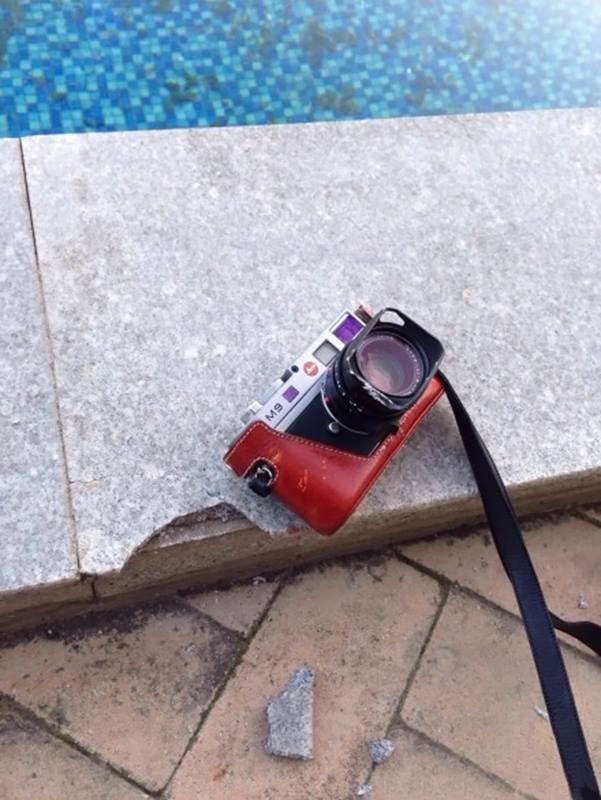 Leica M9 survives fall from balcony, brakes pool granite tile 2
