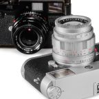 LHSA 50th Anniversary APO-Summicron-M 50mm f/2 in Silver Chrome pictured on an M10, and in Black Paint finish pictured on a Black Paint M2