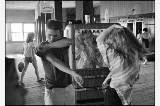 USA New York City 1959 Brooklyn Gang Coney Island Cathey fixing her hair in a cigarette machine mirror