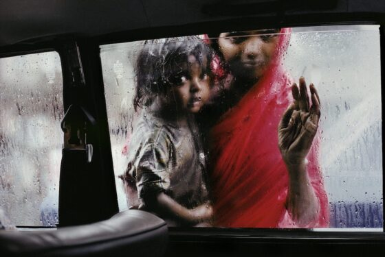 Mother and Child at Car Window. Bombay, India, 1993. © Steve McCurry